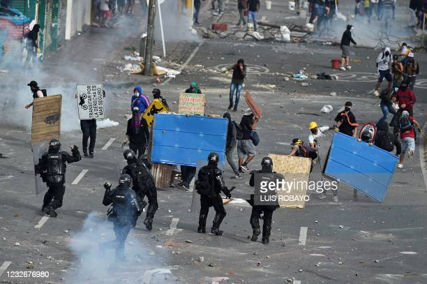 Demonstrators clash with riot police during a protest against a proposed government tax reform in Cali, Colombia, on May 3, 2021. - Protesters in...
