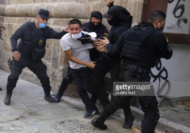 Demonstrators clash with riot police during a protest following the death of a young man while in police custody, after he had been arrested...