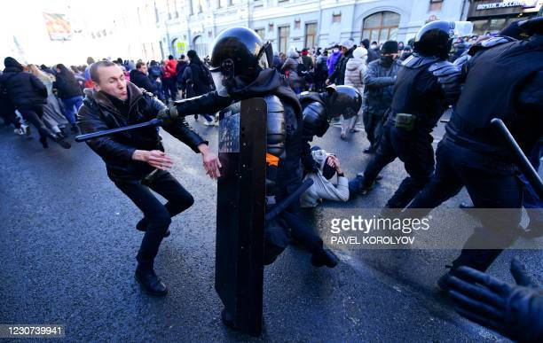 Demonstrators clash with riot police during a rally in support of jailed opposition leader Alexei Navalny in the far eastern city of Vladivostok on...
