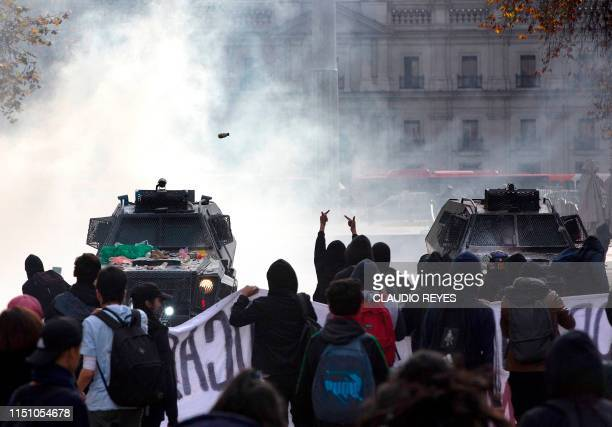 Demonstrators clash with riot police during a teachers' protest against a government's plan that will be implemented in 2020 in which History and...