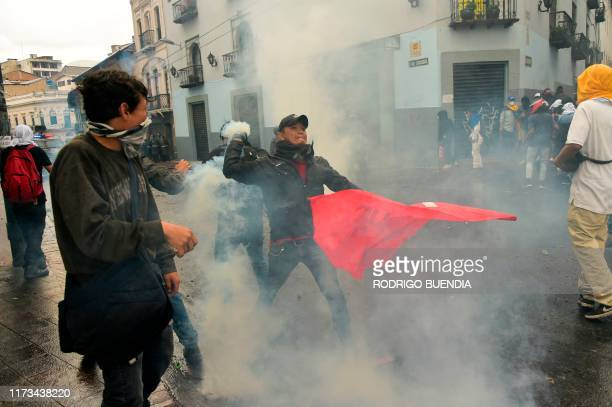 Demonstrators clash with riot police during a transport strike against the economic policies of the government of Ecuadorean President Lenin Moreno...
