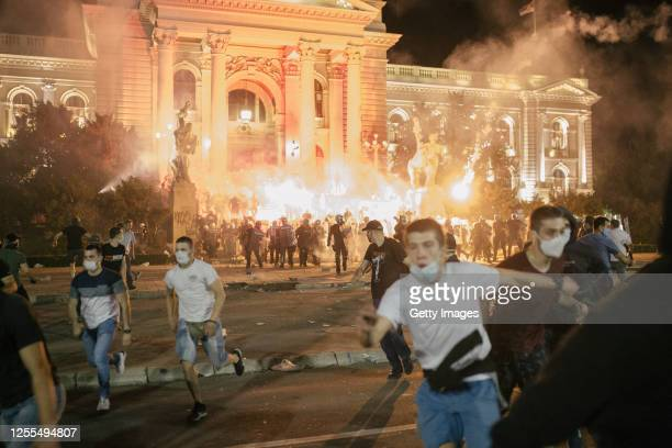 Demonstrators clash with riot police during an anti-government protest on July 10, 2020 in Belgrade, Serbia. Following recent protests, the Serbian...