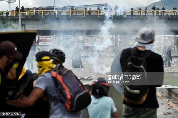 Demonstrators clash with riot police during clashes with riot police during a protest against a proposed government tax reform in Cali, Colombia, on...