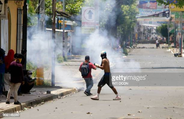 Demonstrators clash with riot police during protests in Monimbo neighborhood in Masaya some 40km from Managua on June 2 2018 The death toll from...