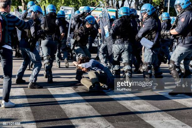 Demonstrators clash with riot police in Lucca Italy on April 10 2017 during a demonstration against G7 Foreign Minister Meeting in Lucca on April...