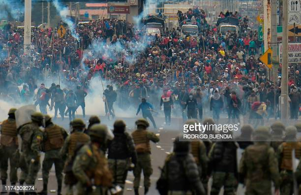 Demonstrators clash with riot police in Quito on October 7, 2019 following days of protests against the sharp rise in fuel prices sparked by...