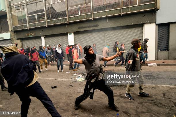 Demonstrators clash with riot police in Quito on October 8, 2019 following days of protests against the sharp rise in fuel prices sparked by...