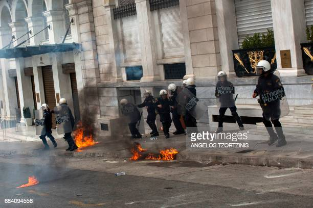 Demonstrators clash with riot police officers in Athens during a 24hour general strike against a new round of austerity cuts imposed by the country's...