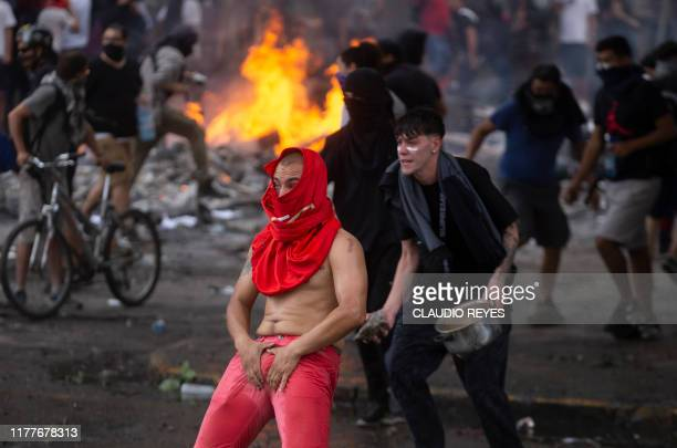 Demonstrators clash with riot police on the fifth straight day of street violence which erupted over a now suspended hike in metro ticket prices in...