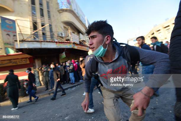 Demonstrators clash with riot police within antigovernment protests in Sulaymaniyah Iraq on December 18 2017 Protests continue as demonstrators keep...