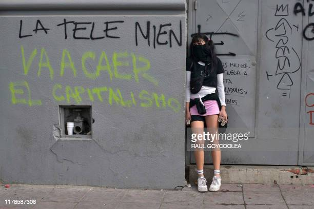 Demonstrators clash with security forces during a demonstration in Valparaiso, Chile on October 27, 2019. - Embattled Chilean President Sebastian...