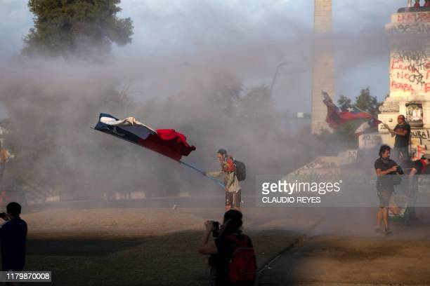Demonstrators clash with security forces during a protest against the government of Chilean President Sebastian Pinera in Santiago on November 3 2019...