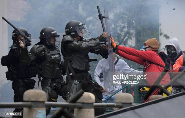 Demonstrators clash with the police during a demonstration against the tax reform proposed by the Colombian President Ivan Duque, in Bogota, on April...