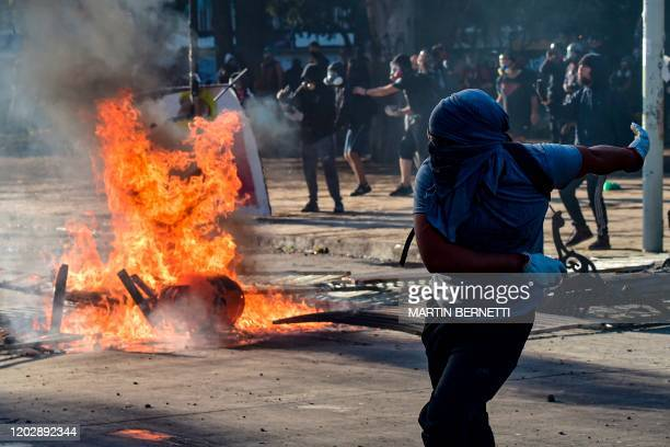 Demonstrators clash with the police during a protest against Chilean President Sebastian Pinera's government in Vina del Mar, on February 23 during...