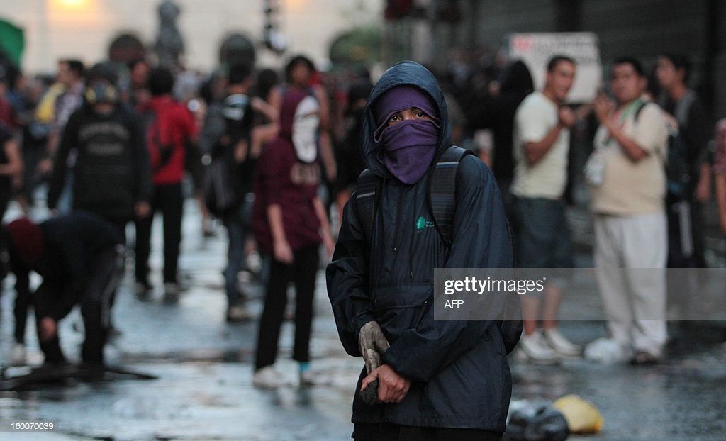 Demonstrators clash with the riot police during a march of the Peoples' Summit 'for Social Justice, International Solidarity and in Defence of the Commons', held in the sidelines of the weekend's CELAC-EU Summit, in downtown Santiago on January 25, 2013. More than 40 Heads of State and Government of the Community of Latin American and Caribbean States (CELAC) and the European Union (EU) will meet on January 26 and 27 to promote a strategic partnership between the two regions.
