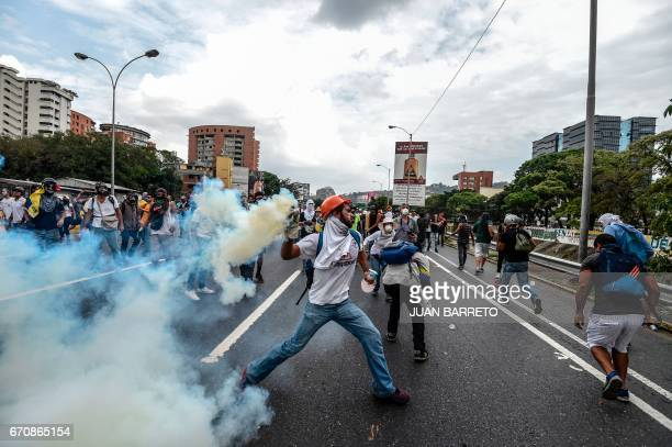 Demonstrators clash with the riot police during a protest against Venezuelan President Nicolas Maduro in Caracas on April 20 2017 Venezuelan riot...