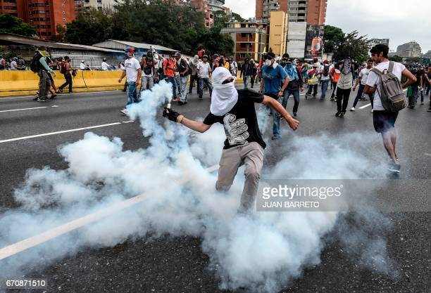 TOPSHOT Demonstrators clash with the riot police during a protest against Venezuelan President Nicolas Maduro in Caracas on April 20 2017 Venezuelan...