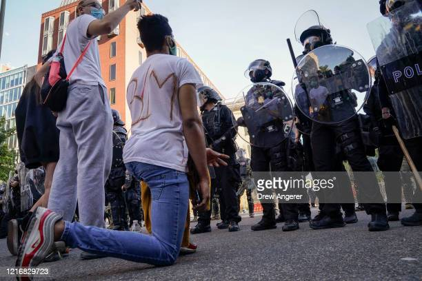 Demonstrators confront law enforcement during a protest on June 1 2020 in downtown Washington DC Protests and riots continue in cities across America...