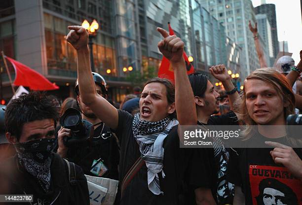 Demonstrators confront police as they march through the downtown streets on May 19 2012 in Chicago Illinois This was the sixth day of protests in...