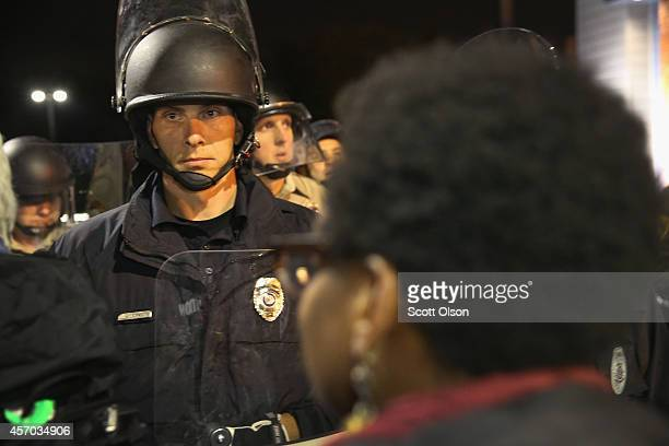Demonstrators confront police during a protest outside the Ferguson police department on October 10 2014 in Ferguson Missouri Ferguson has been...