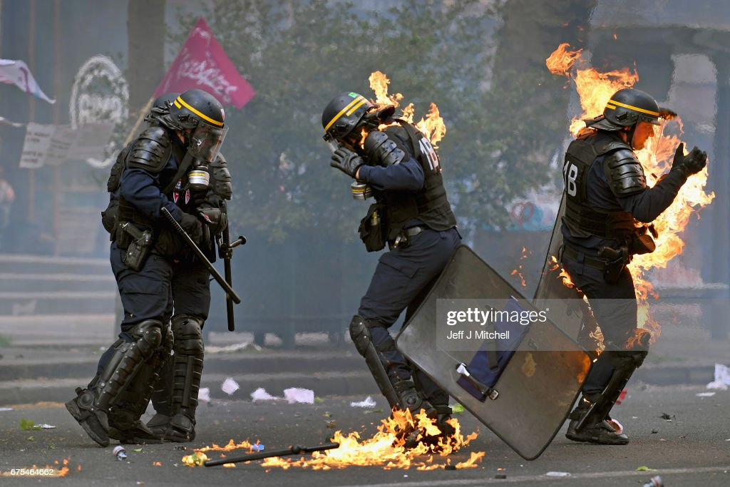 Demonstrators confront police on the annual May Day worker's march on May 1, 2017 in Paris, France. Police dealt with violent scenes in central Paris during the rally held close to the Place de la Bastille, where protestors shouted 'Fascists out!'