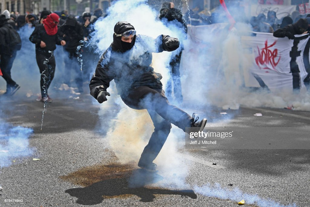 Demonstrators confront police on the annual May Day worker's march on May 1, 2017 in Paris, France. Police dealt with violent scenes in central Paris during the rally held close to the Place de la Bastille, where protestors shouted 'Fascists out!'.