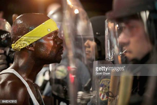 Demonstrators confront police while protesting the acquittal of former St Louis police officer Jason Stockley on September 16 2017 in St Louis...