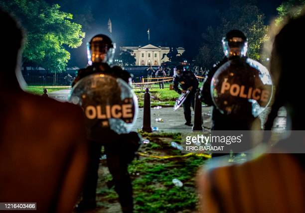 TOPSHOT Demonstrators confront secret service police and Park police officers outside of the White House on May 30 2020 in Washington DC during a...