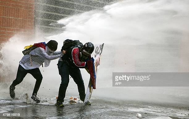 Demonstrators confront the National Police during a protest against Venezuelan President Nicolas Maduro in Caracas on March 20 2014 Demonstrators...