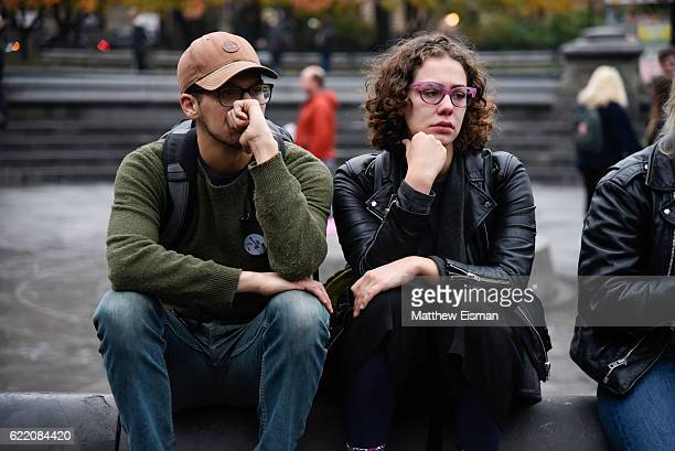 Demonstrators console each other while protesting against Donald Trump's presidency at Washington Square Park on November 9 2016 in New York City