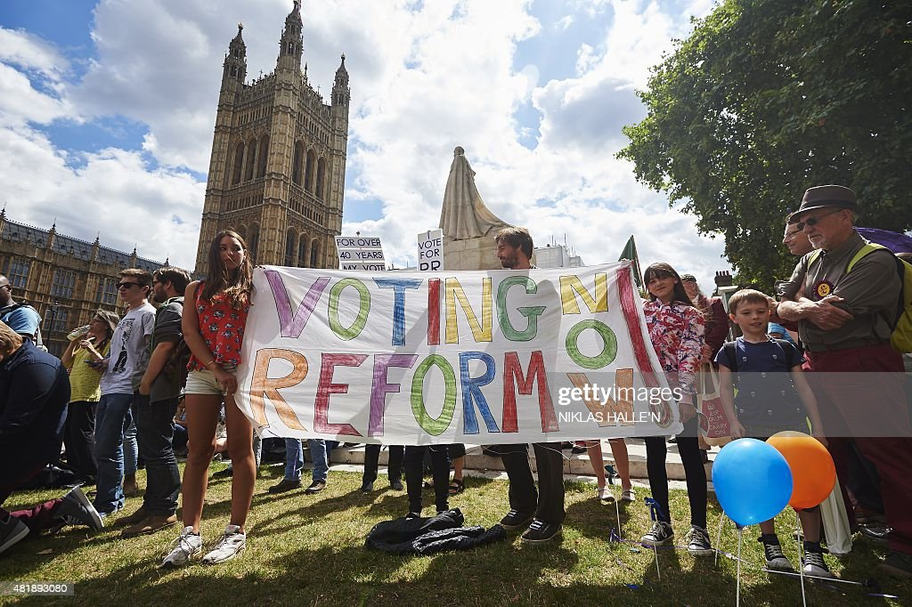 Demonstrators converge outside the Houses of Parliament in a rally to demand electoral reform in central London on July 25, 2015. AFP PHOTO / NIKLAS HALLE'N
