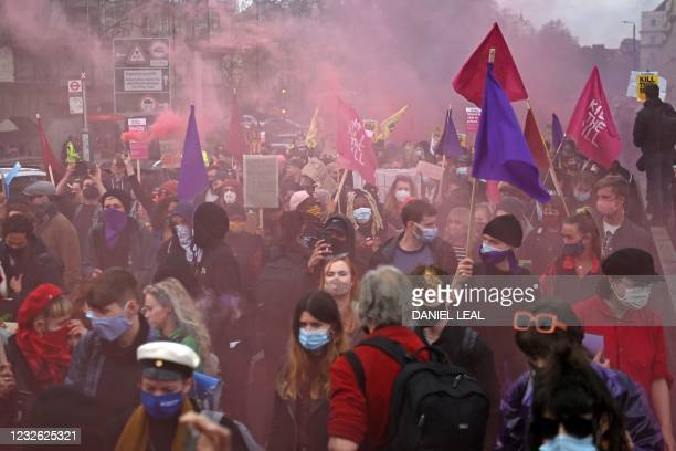 Demonstrators cross Vauxhall Bridge as they protest against the Police, Crime, Sentencing and Courts Bill 2021 in central London on May 1, 2021. -...