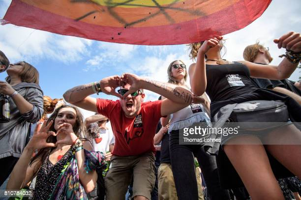 Demonstrators dance to techno music while they attend a protesters march under the topic 'Grenzenlose Solidaritaet statt G20' against the G20 Summit...