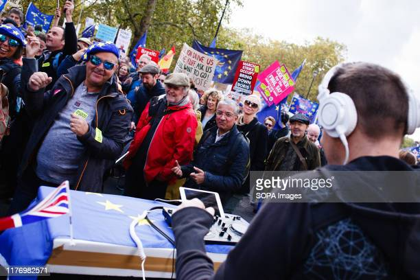 Demonstrators dance to the music played by a DJ on Piccadilly during the protest A mass 'Together for the Final Say' march organised by the 'People's...