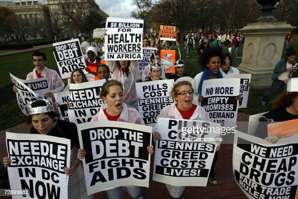 Demonstrators demand needle exchange programs and lower prices for medicines that fight HIV/AIDS in front of the White House on World AIDS Day...