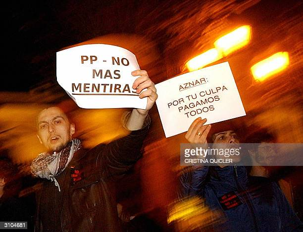 Demonstrators denouce Spanish Prime Minister Jose Maria Aznar's ruling Popular Party in Seville 13 March 2004 as governmentcalled demonstrations in...