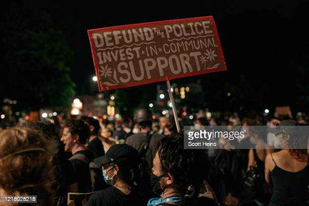 Demonstrators denouncing systemic racism and the police killings of African Americans take to the streets in the borough of Brooklyn on June 6 2020...