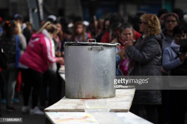 Demonstrators distribute ''polenta'' during an antigovernment protest against economic policies around the Obelisco in Buenos Aires Argentina on July...