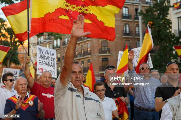 Demonstrators do the fascist salute during a protest against the independence of Catalonia under the slogan 'For the unity of Spain' called by far...