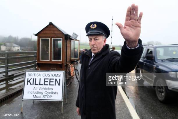 Demonstrators dressed as custom officials set up a mock customs checkpoint at the border crossing in Killeen near Dundalk to protest against the...