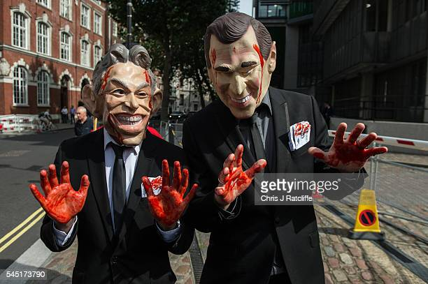 Demonstrators dressed as former British Prime Minister Tony Blair and former US President George Bush Jr arrive with painted red hands and in hand...
