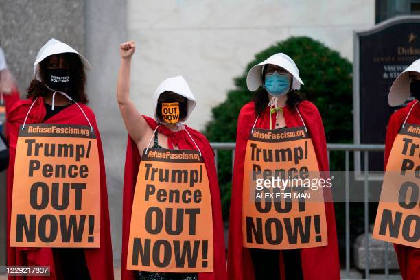 Demonstrators dressed as Handmaid's Tale protest the nomination of Amy Coney Barrett to be a US Supreme Court Justice at the US Supreme Court in...