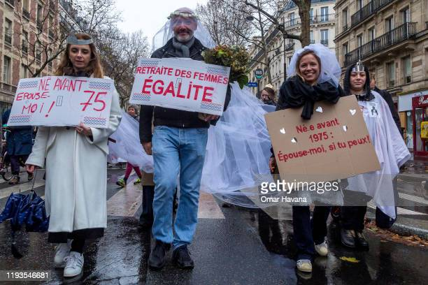 Demonstrators dressed in wedding gowns march carrying messages in favor of pensions for women and those born after 1975 during the eighth day of a...