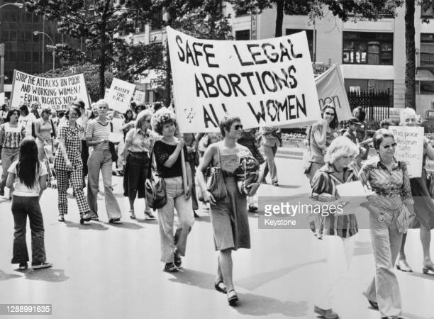 Demonstrators during a march calling for safe legal abortions for all women, in New York City, New York, 1978. The banners carried by the march read...
