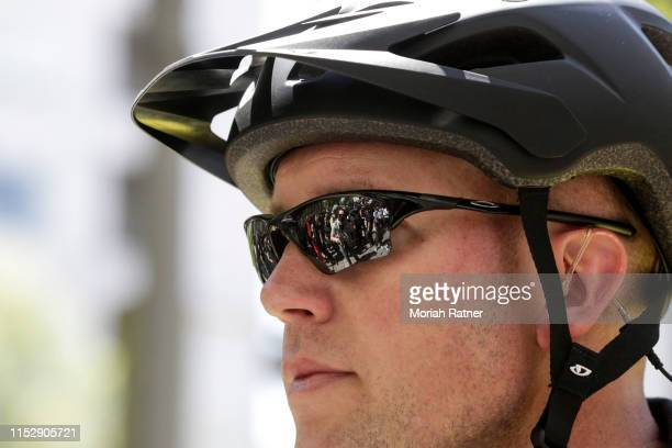 Demonstrators during a protest between the left and right are seen in the reflection of a Portland Police officer's glasses on June 29 2019 in...