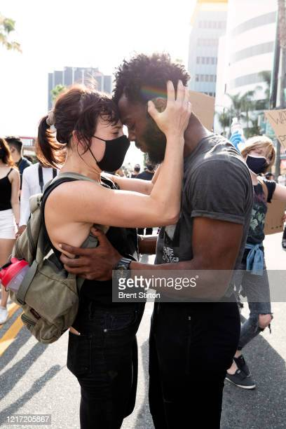 Demonstrators embrace during a march in response to George Floyd's death on June 2 2020 in Los Angeles California Floyd died while in Minneapolis...
