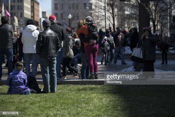 Demonstrators embrace on Pennsylvania Avenue during the March For Our Lives in Washington DC US on Saturday March 24 2018 Thousands of high school...