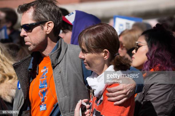 Demonstrators embrace while gathering on Central Park West during the March For Our Lives in New York, U.S., on March 24, 2018. Thousands of high...