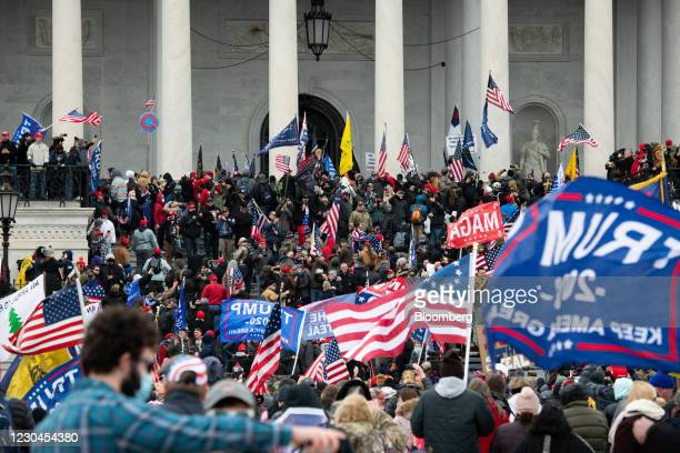 Demonstrators enter the U.S. Capitol after breaching security fencing during a protest in Washington, D.C., U.S., on Wednesday, Jan. 6, 2021. The...