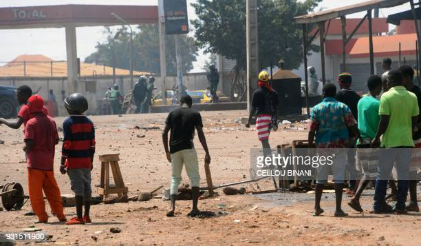 Demonstrators erect a roadblocks and set fire to tyres on a street in Conakry on March 13 during a protest against Guinea's President Alpha Conde /...